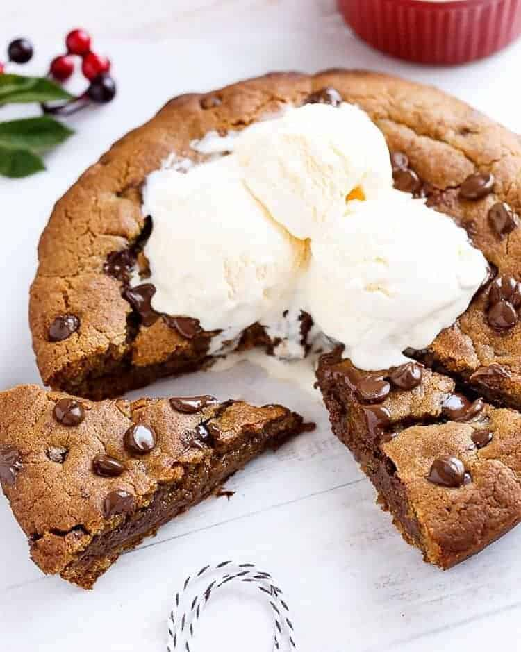 Nutella Stuffed Browned Butter Gingerbread Skillet Cookie | https://cafedelites.com