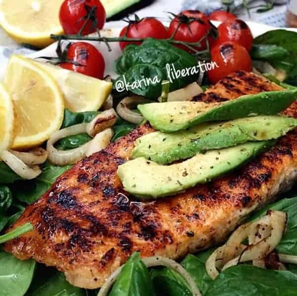 Chargrilled Salmon and Cherry Tomatoes on a Spinach, Basil and Garlic Olive Oil Salad