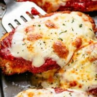 The Best Chicken Parmesan with a deliciously crispy breadcrumb coating, smothered in a rich homemade tomato sauce and melted mozzarella cheese! This is here best Chicken Parmesan you will ever make! Simple to make and worth every minute. If you love a crispy crumb coating vs soggy crumb, look no further!   cafedelites.com