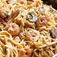 Creamy Shrimp Mushroom Linguine! Pasta, shrimp in a creamy low fat sauce without losing the creamy flavour? Of course! You won't miss the heavy cream! | cafedelites.com