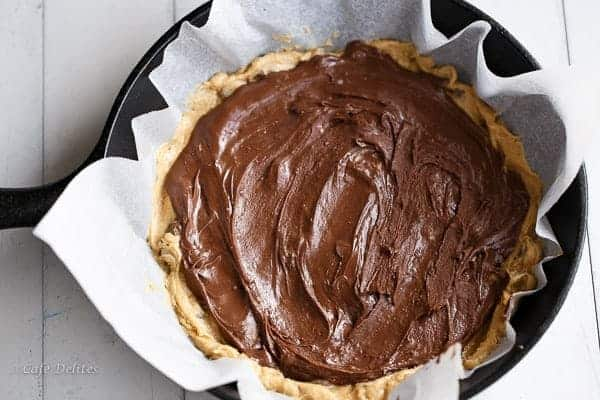 Nutella Stuffed Deep Dish Skillet Cookie | https://cafedelites.com