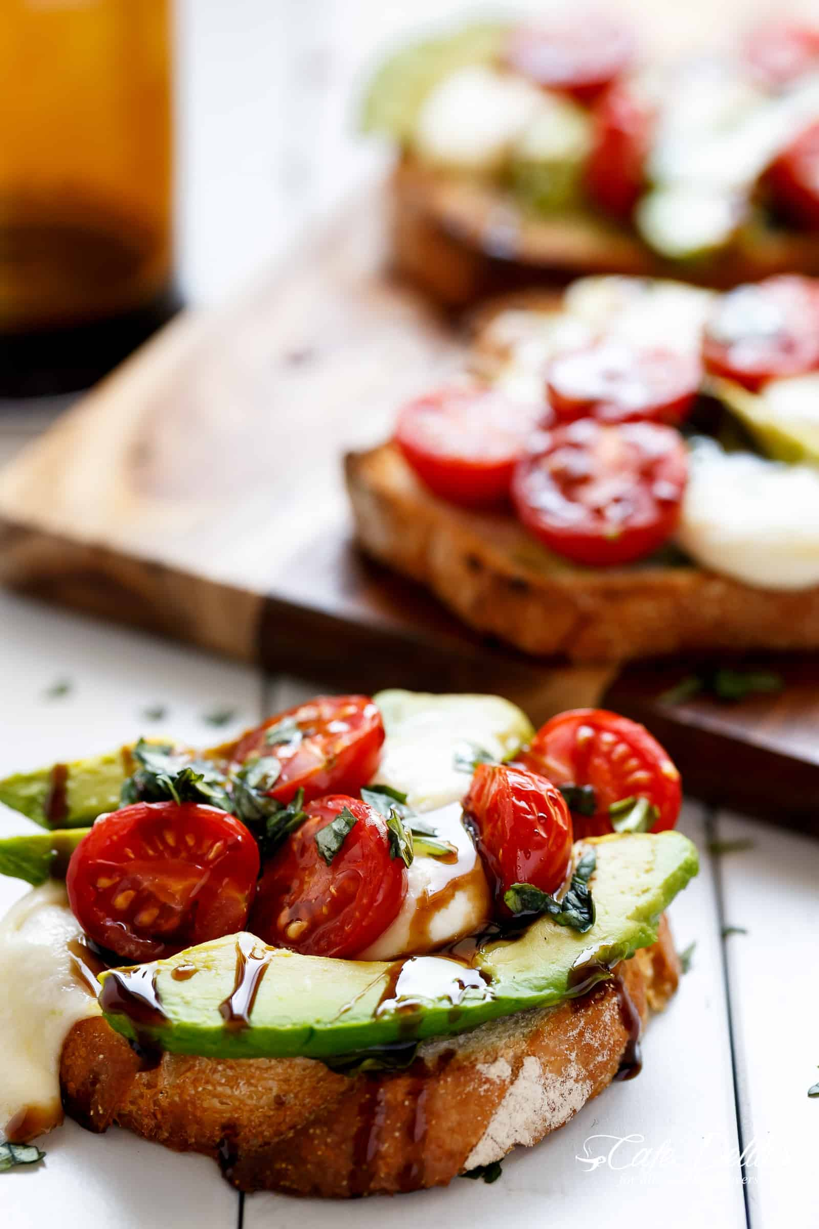 Grilled Avocado Caprese Crostini are the ultimate EASY appetizers infused with olive oil and piled high with Caprese flavours!