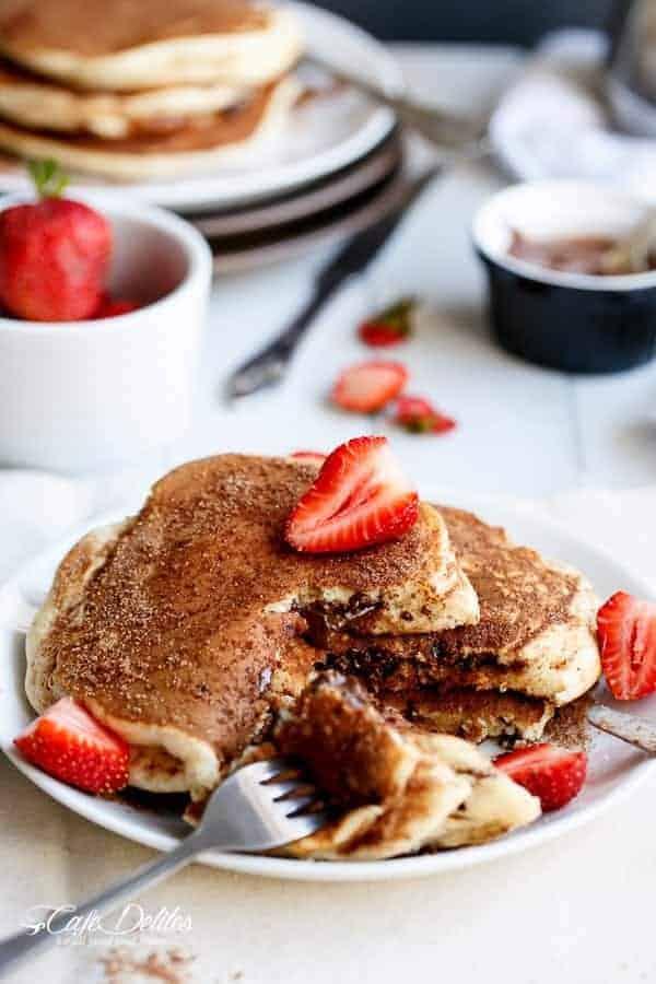 Chocolate Stuffed Churro Pancakes | https://cafedelites.com