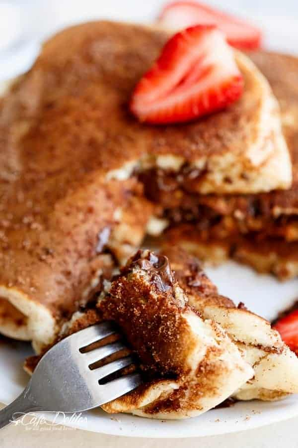 Chocolate Stuffed Churro Pancakes | https://cafedelites.com