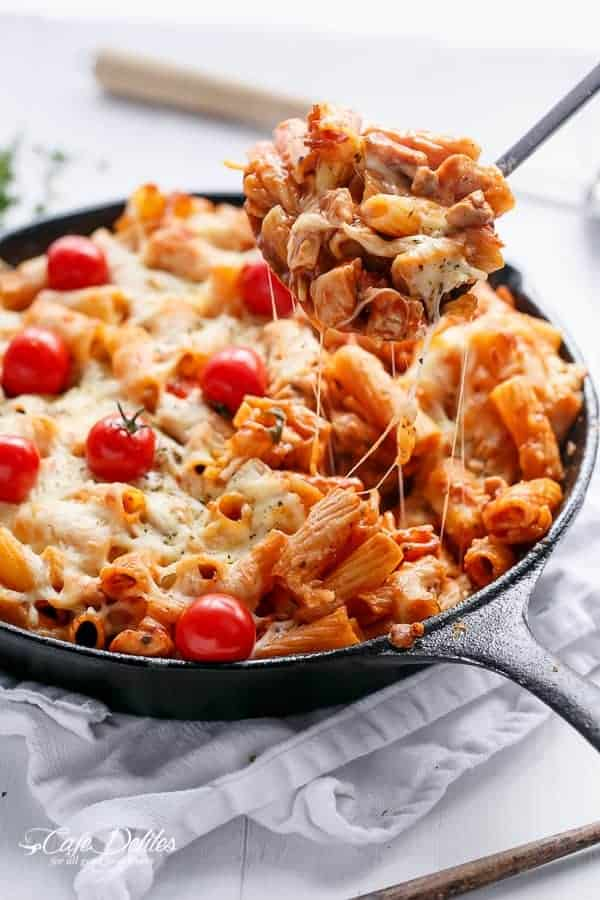 Cheesy Chicken and Roasted Tomato Mozzarella Pasta Bake | https://cafedelites.com