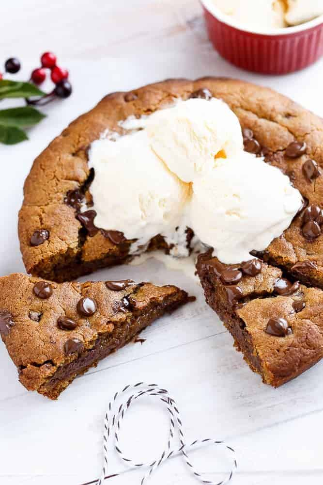 A Nutella Stuffed Browned Butter Gingerbread Skillet Cookie that kids and adults will demolish at Christmas! | https://cafedelites.com