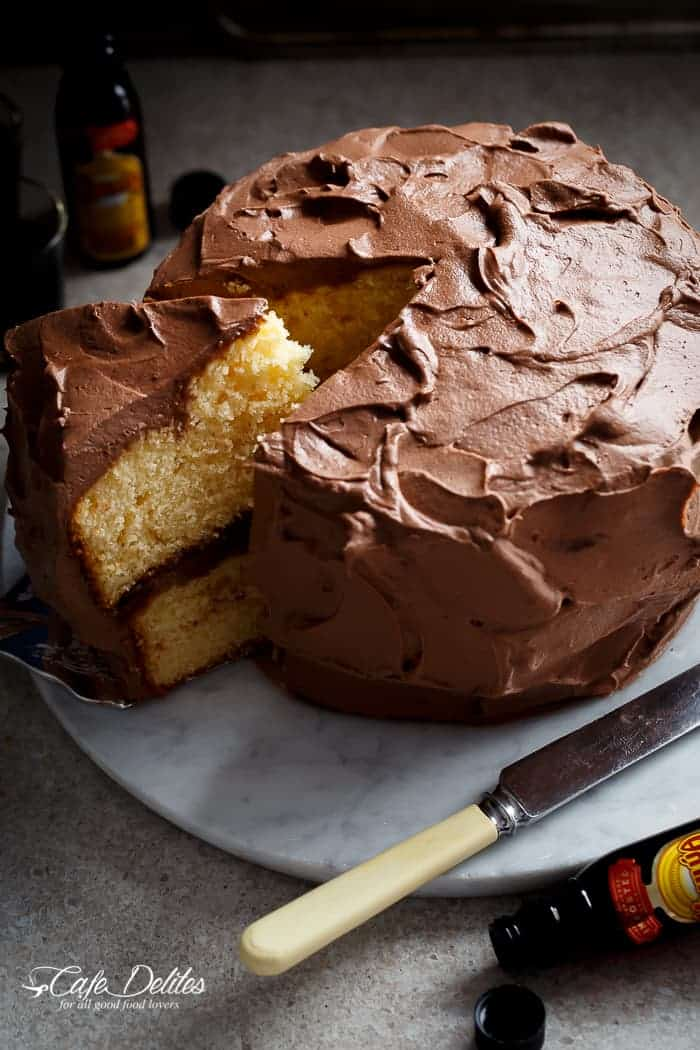 A fluffy and super moist butter cake with Kahlua chocolate cream frosting to make all of your dreams come true! | https://cafedelites.com