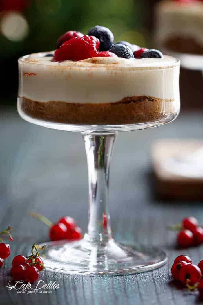 With a gingerbread cookie base and sugared berries as a topping, these mini no bake eggnog cheesecakes -- parfaits or trifles -- will get you through Christmas and future Thanksgiving dinners | https://cafedelites.com