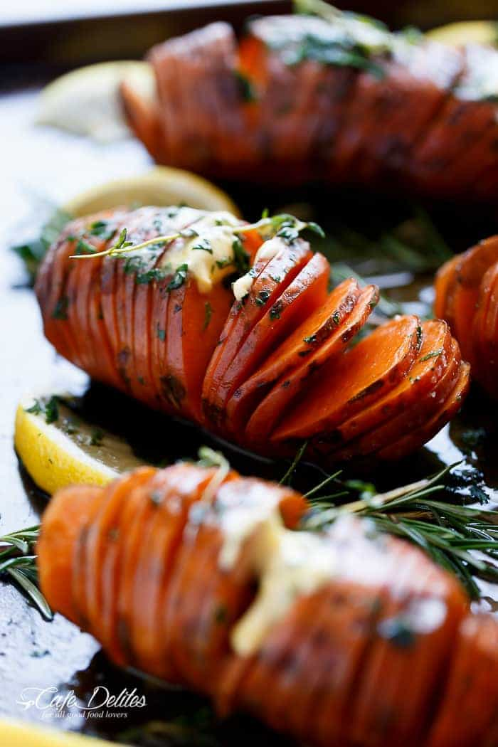 Hasselback Herbed Garlic Butter Sweet Potatoes are just as good, if not BETTER than potatoes! | https://cafedelites.com