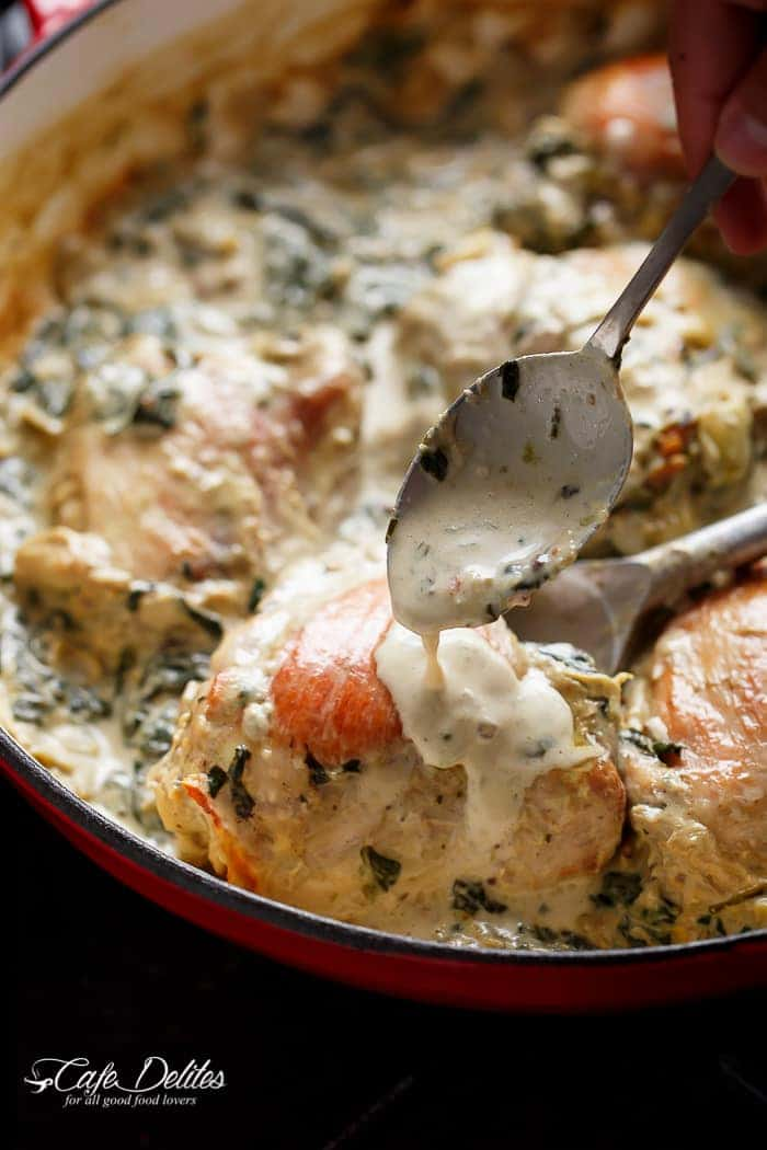 Creamy Spinach Artichoke Chicken Thighs in one skillet! Low fat AND low carb, filled with fresh spinach, artichokes, parmesan cheese and a hint of garlic! | https://cafedelites.com