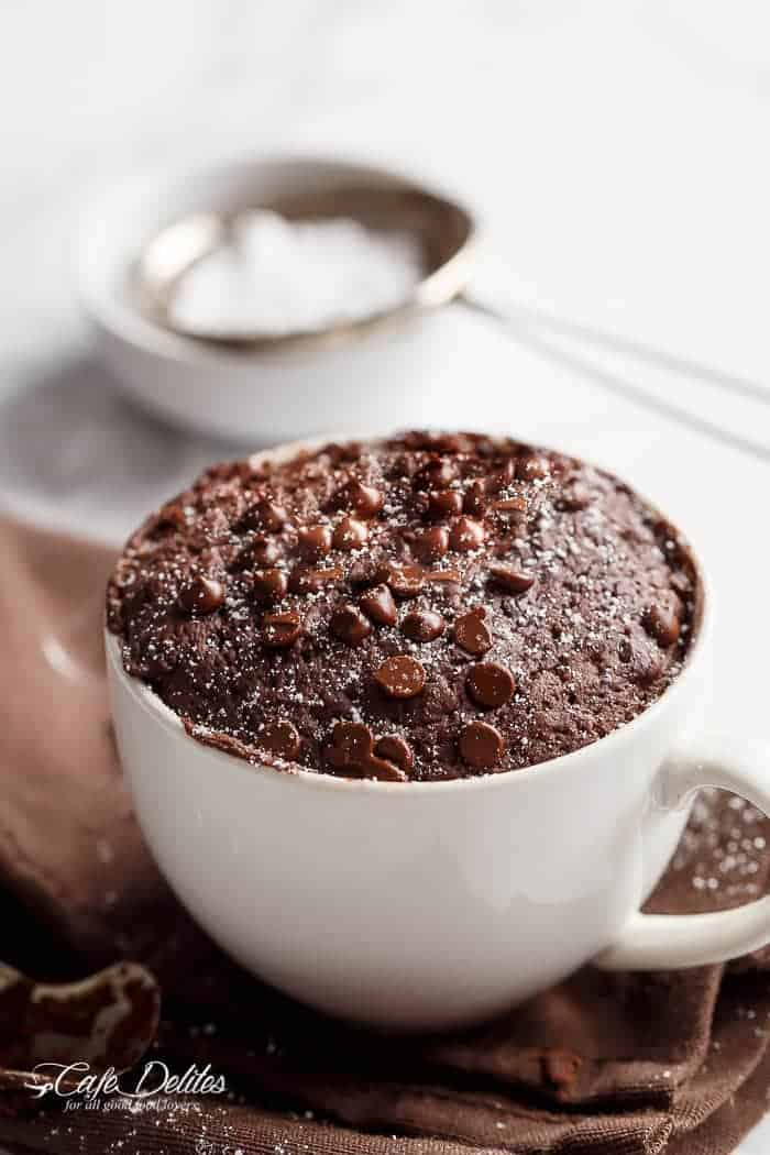 Low Fat Double Chocolate Mug Cake recipe WITH another video. Ready in less than one minute! Fluffy. Buttery and soft. The BEST low fat, guilt-free mug cake! | https://cafedelites.com