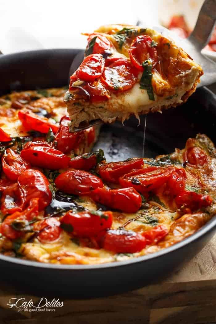 Garlic infused, Caprese Frittata with pan fried, juicy tomato and fresh basil flavors. Breakfast, brunch, lunch or dinner! Easy to make and low carb/cal! | https://cafedelites.com