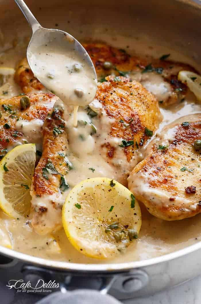 The ultimate in gourmet comfort food with parmesan cheese, garlic and a creamy lemon sauce, this Creamy Lemon Parmesan Chicken Piccata is out of this world. With NO heavy cream! | https://cafedelites.com