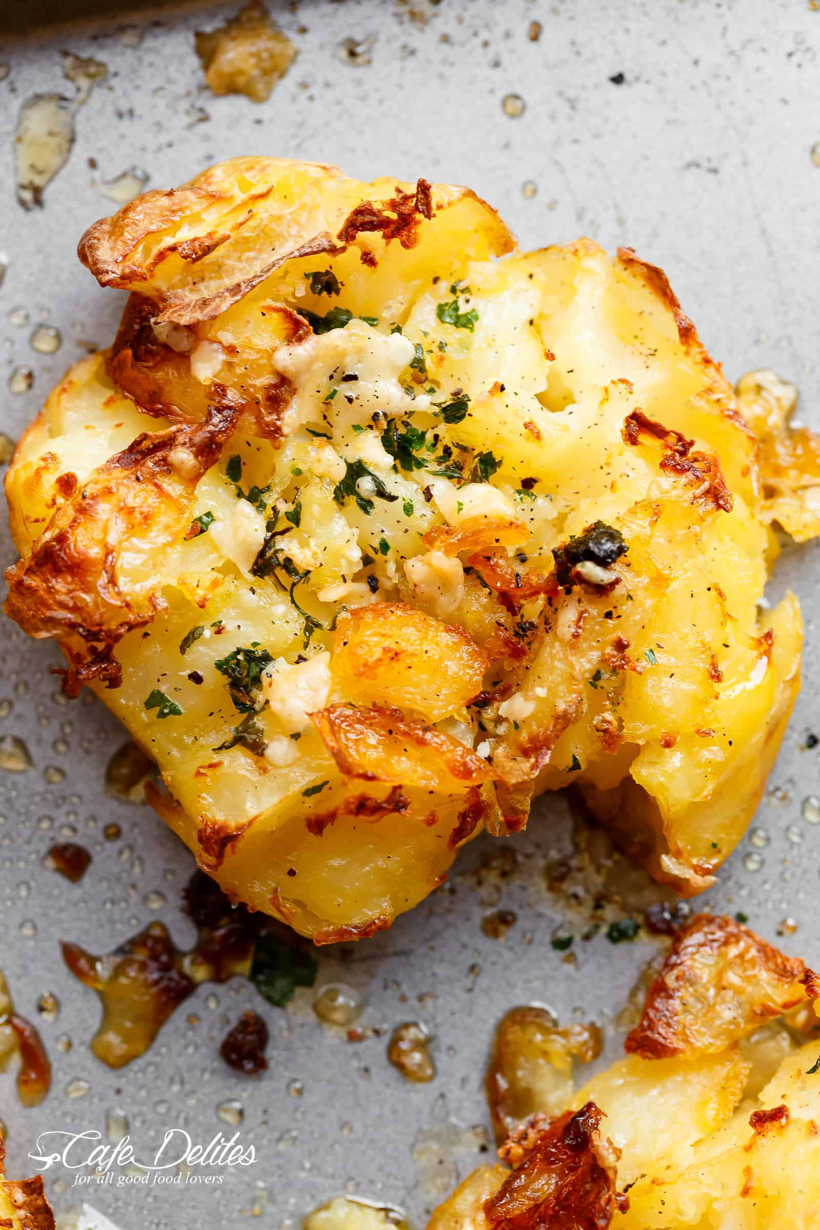 Crispy Garlic Butter Parmesan Smashed Potatoes with crispy edges that will send you over the edge! | http://cafedelites.com