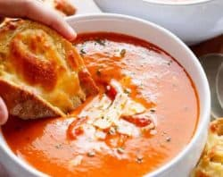 A Creamy Roasted Tomato Basil Soup full of incredible flavours, naturally thickened with no need for cream cheese or heavy creams! | https://cafedelites.com