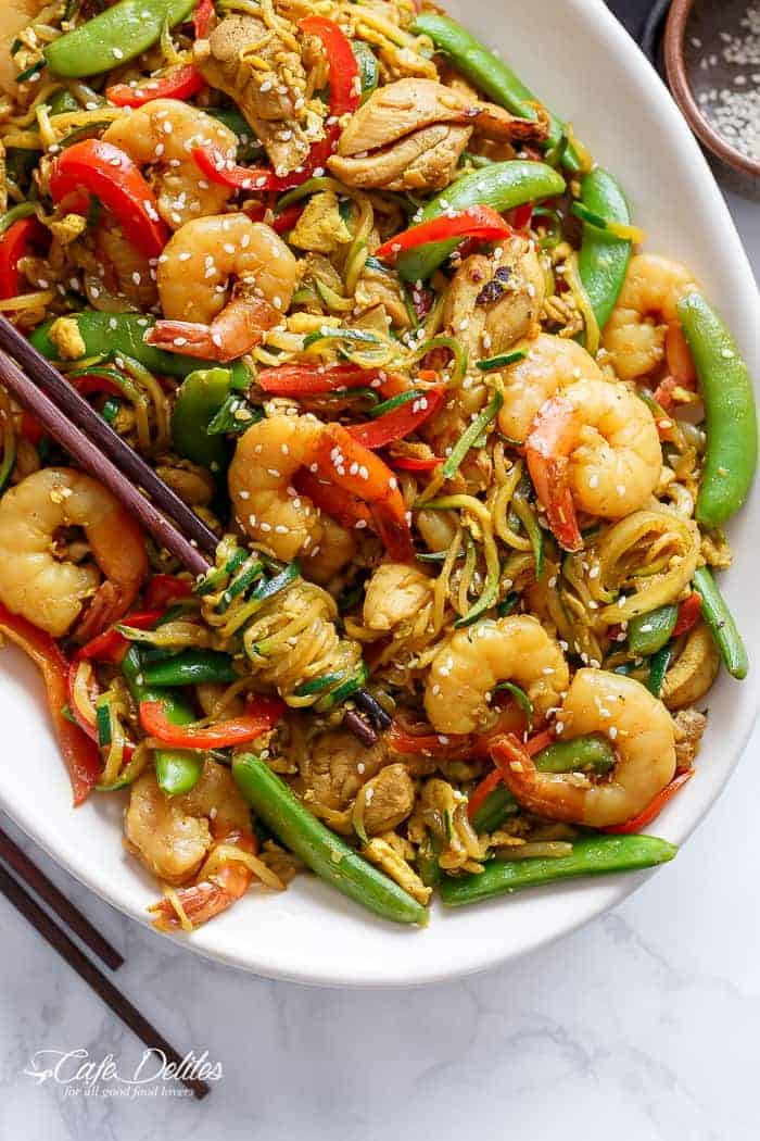 A twist on the classic Singapore Noodles -- same classic flavours only low carb and low calories with Singapore Zoodles! | https://cafedelites.com