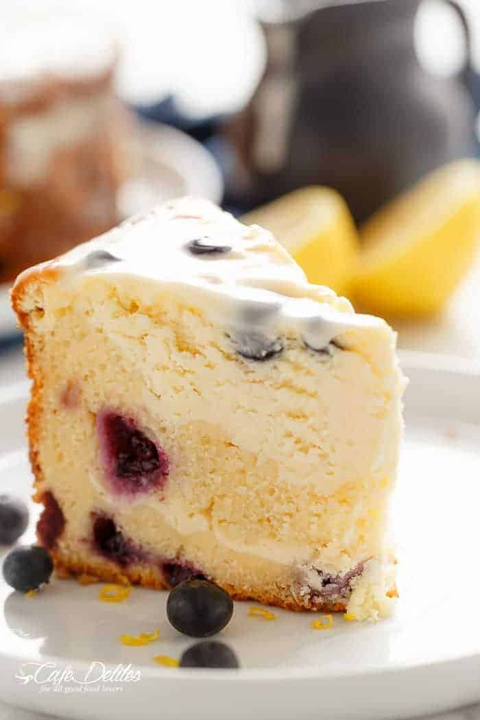 Blueberry Lemon Cheesecake Cake with a Lemon Cream Cheese Glaze to kick start your season! Baked in the one pan Easy to make with no layering! | https://cafedelites.com