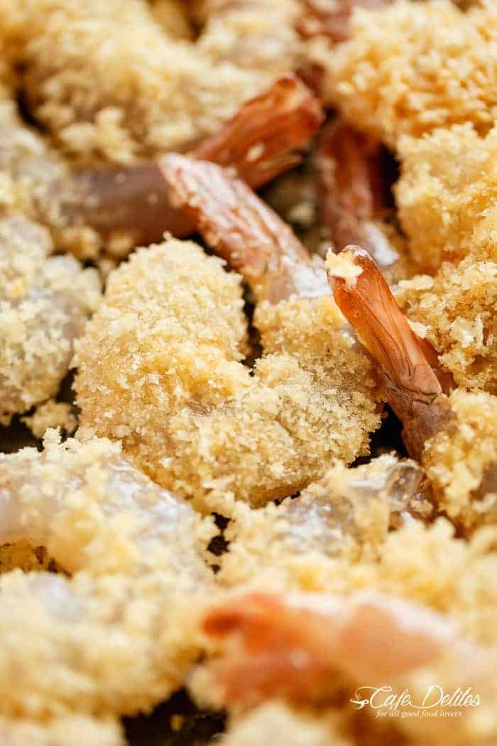 Crispy Oven Fried Crumbed Shrimp! Fresh shrimp dipped in a lightened up batter, coated in Panko for that crispy deep-fried texture without the extra fat! | https://cafedelites.com