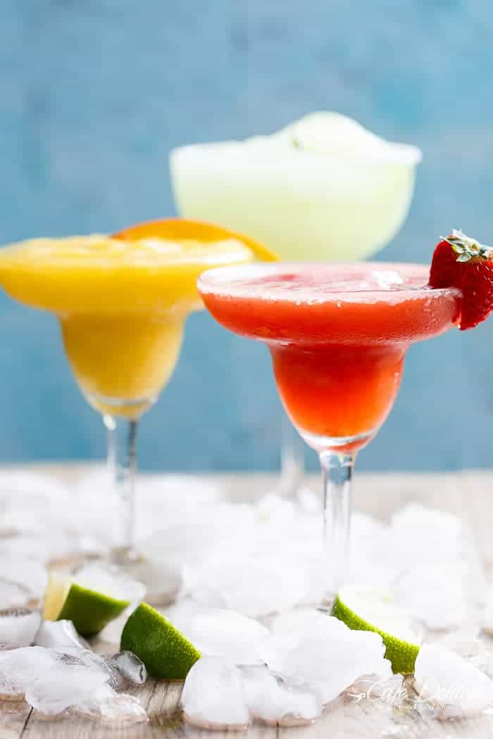 Frozen Strawberry and Mango Margaritas are refreshing and fruity and even better than the original Margarita! Celebrate in style! | https://cafedelites.com