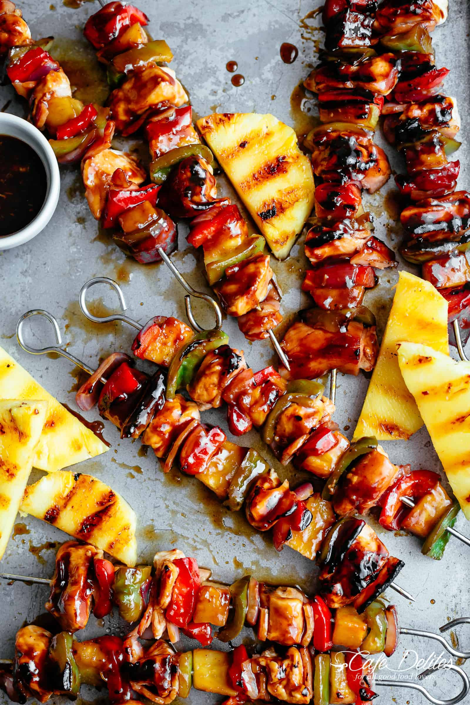 Hawaiian Bacon Pineapple Chicken Kebabs smothered in a garlicky-BBQ sauce! | https://cafedelites.com