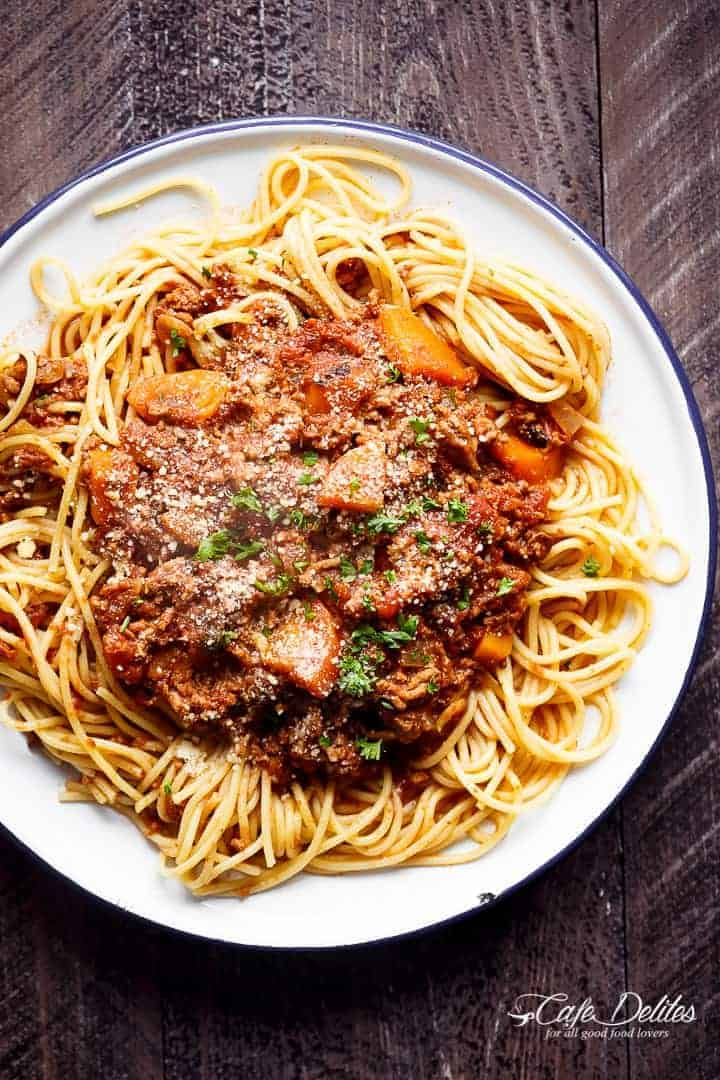 Easy to make rich and rustic Slow Cooker Bolognese Sauce, packed with so much flavour to coat your pasta (or vegetables) of choice! | https://cafedelites.com