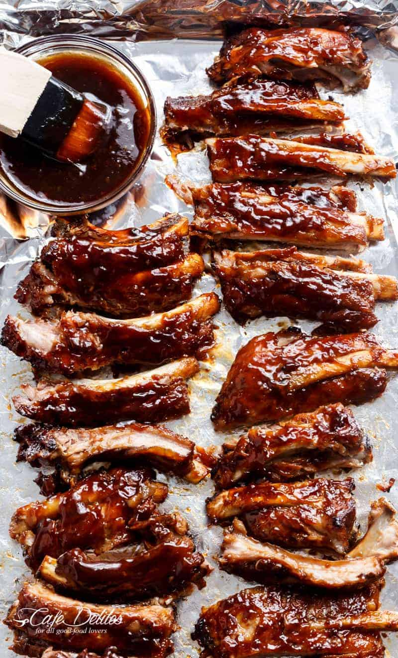 Easy Slow Cooker Barbecue Spare Ribs are melt-in-your-mouth incredible! Let your slow cooker do all the work and come home to sticky, fall apart ribs! | https://cafedelites.com