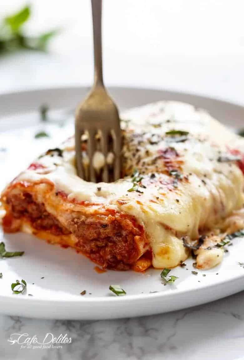 These Easy Lasagna Stuffed Burritos are a family favourite! Stuffed with lasagna meat sauce, lasagna flavours, and plenty of melted mozzarella cheese! | https://cafedelites.com