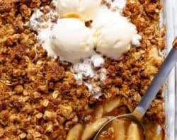 Easy Cinnamon Apple Crumble is foolproof! A juicy apple pie filling is covered with a crispy oatmeal cookie-like topping! BEST apple crumble!