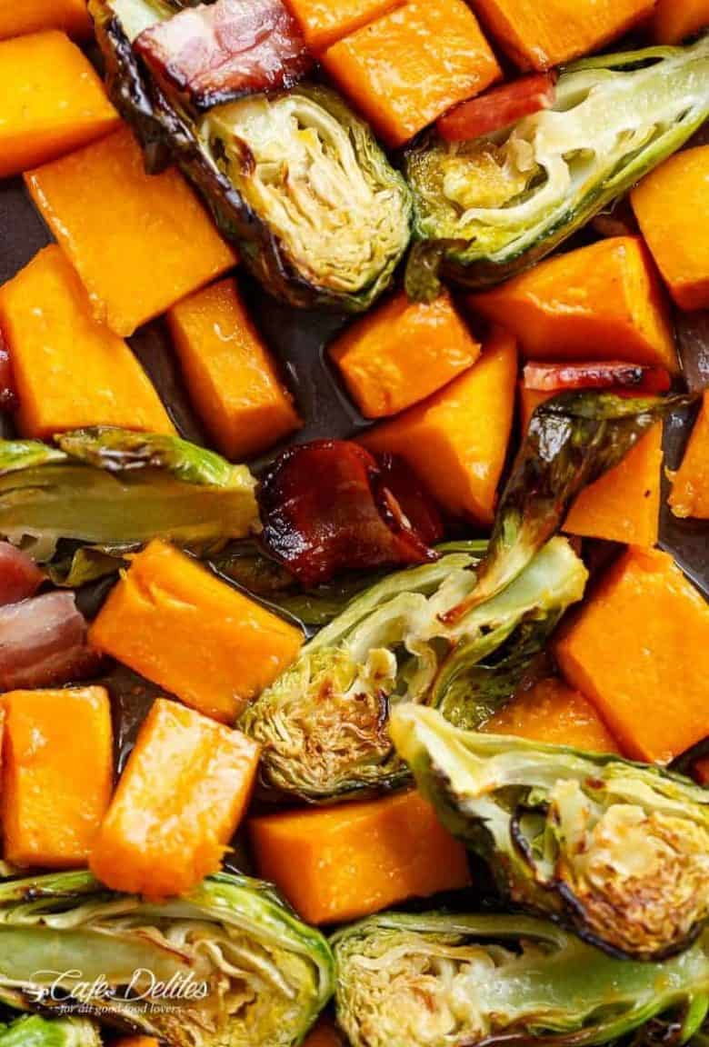 Honey Roasted Butternut Squash & Brussels Sprouts With Crispy Bacon Pieces in a simple 2 ingredient coating for roasting! | https://cafedelites.com