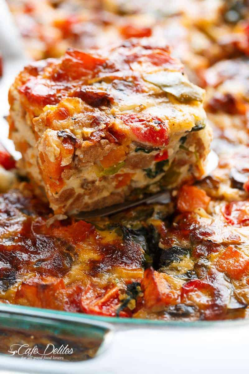 An easy and heathy LOADED Sweet Potato Hash Brown Breakfast Casserole, complete with as many vegetables as YOU want, crumbled sausages, eggs and crisp-tender sweet potato hash browns! | https://cafedelites.com