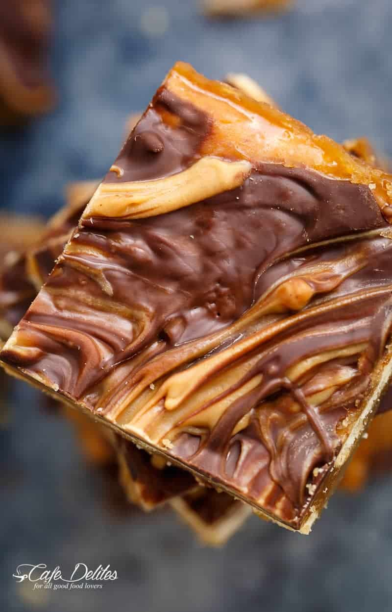 Peanut Butter Swirl Saltine Toffee (Christmas Crack) is all of your Christmas dreams come true – on crack! It's easy to make with only FIVE INGREDIENTS! | https://cafedelites.com