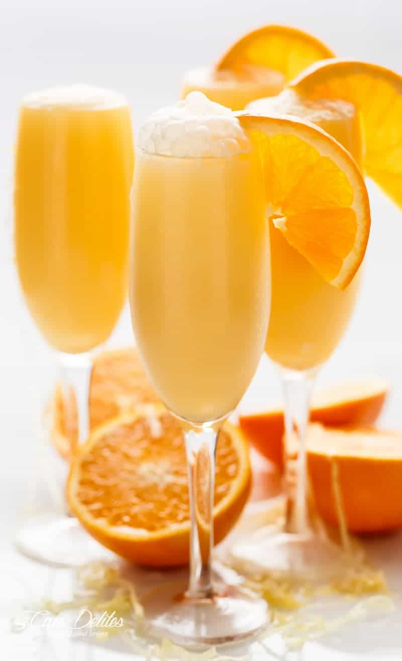 Orange Creamsicle Mimosas is the perfect refreshing beverage to add to your breakfast or brunch menu! A champagne cocktail that tastes just like a Creamsicle! | http://cafedelites.com