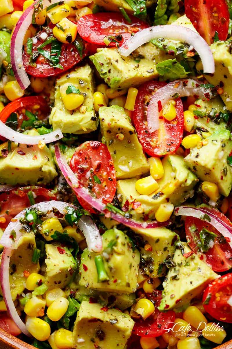 Avocado Corn Tomato Salad with a lime juice dressing is delicious served on its own, or as a side that easily pairs with anything on your plate! | https://cafedelites.com