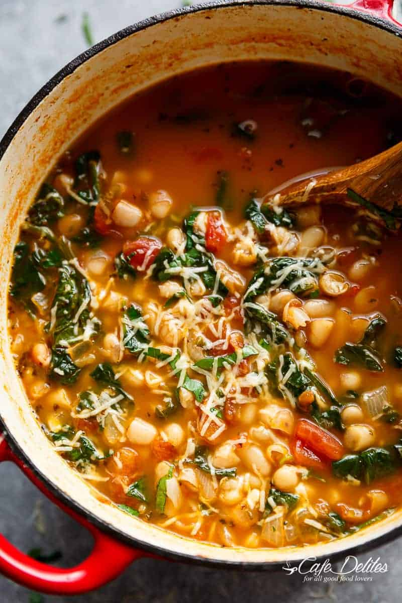 White Bean Parmesan Spinach Soup ready in 10 minutes is may kind of soup! Make a double batch and have plenty of leftovers for the weekly dinner rush! | https://cafedelites.com