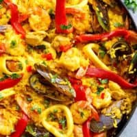 This Classic Spanish Paella rivals any restaurant paella! Sometimes nothing compares to good home cooking, and recipe by a beloved mother | https://cafedelites.com