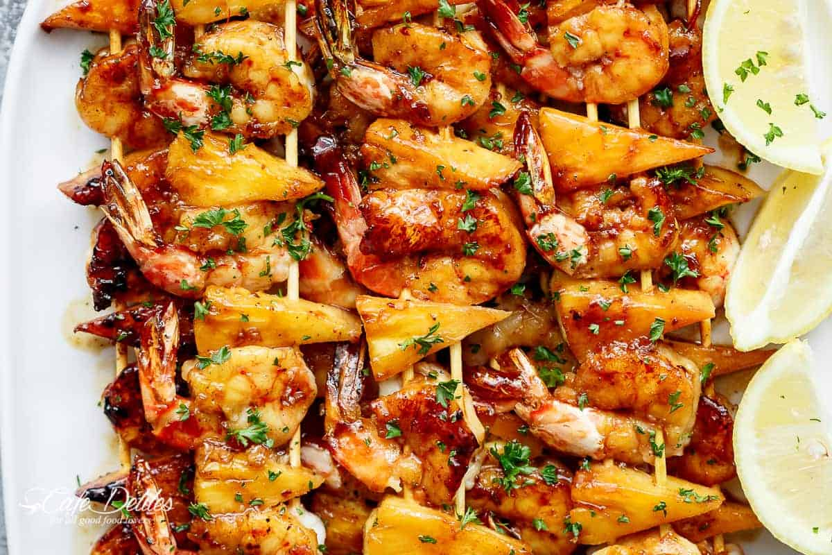 Honey Garlic Butter Shrimp Pineapple Skewers are cooked in the most incredible honeygarlic butter sauce! Sweet and buttery, a family favourite! | https://cafedelites.com