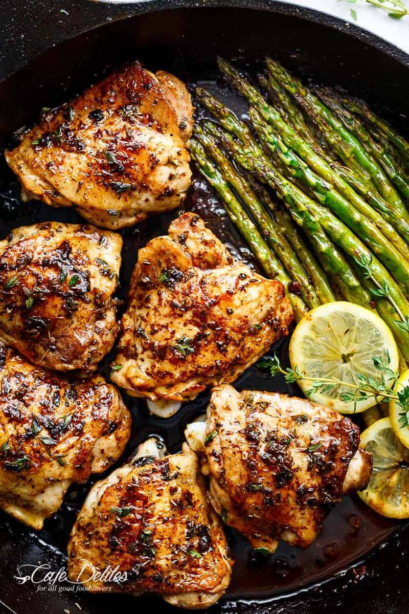 One Pan Lemon Thyme Chicken Asparagus is a super easy 'throw-together' recipe. Healthy and made with only a handful of uncomplicated ingredients! | https://cafedelites.com