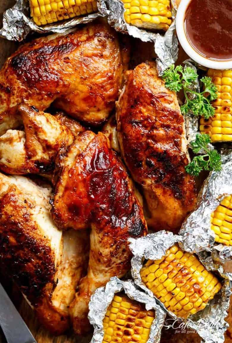 Bring your favourite Nando's chicken to the table with this Portuguese BBQ Peri Peri Chicken Recipe! PLUS the addition of juicy corn cobs in foil packets are charred for added flavour. | https://cafedelites.com