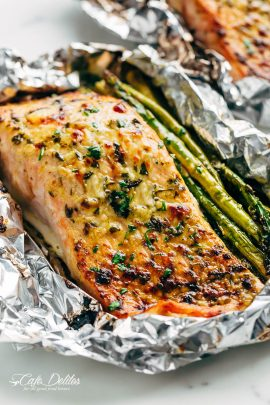 Lemon Parmesan Salmon & Asparagus Foil Packs are so easy to make, and are packed with flavour! Baked OR grilled right on your barbecue! | https://cafedelites.com
