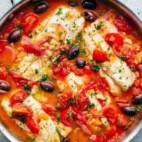 Pan Seared Fish With Tomatoes & Olives is a family favourite and weeknight staple recipe! Light and flavourful, a simple meal in minutes! | https://cafedelites.com