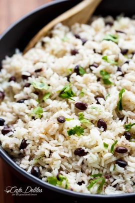Black Beans & Rice is one of the best side recipes out there! Flavoured with a squeeze of lime juice, garlic and spices, this rice recipe is a winner! | https://cafedelites.com