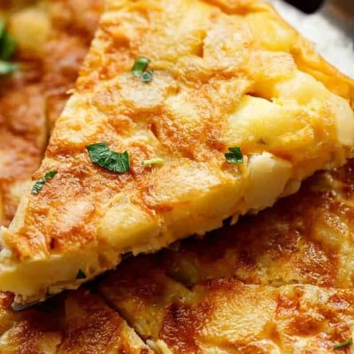 Spanish Omelette (Spanish Tortilla) is perfect served hot or cold, and so easy to make! Crispy, fried potatoes and eggs make up this popular Spanish Tortilla recipe, perfect for picnics, parties, bbq's, or your traditional Tapas menu! Upgrade your omelette! | https://cafedelites.com