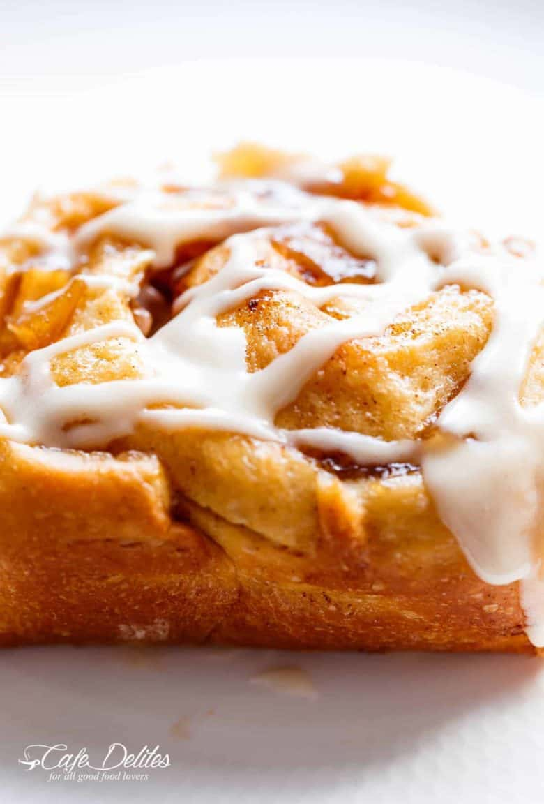 Apple Pie Cinnamon Rolls are soft and fluffy, filled with apple pie filling to make the ultimate twist for your dinner table! | cafedelites.com
