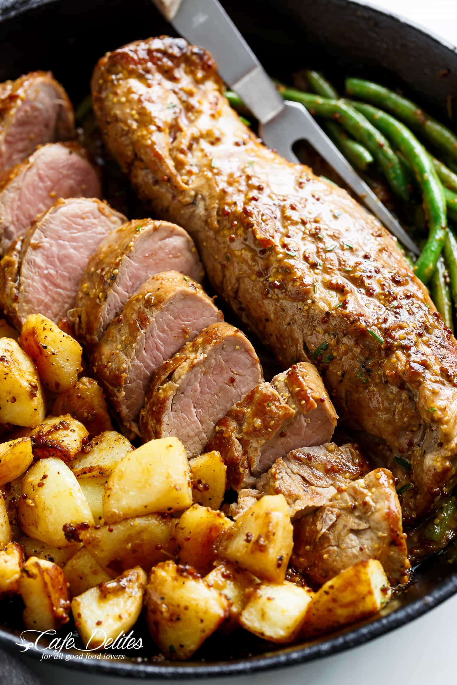 One Pan Dijon Garlic Pork Tenderloin & Veggies is a complete meal with crispy potatoes and tender green beans! All of the flavours cook together! | cafedelites.com