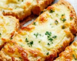 Wantjust one piece of garlic bread? Individual Garlic Cheese Breadsare quickto make and can be served with just about anything! Soups, pastas, steak and potatoes, stews, ANYTHING! | cafedelites.com