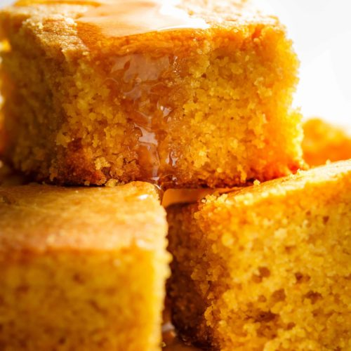 Easy Buttermilk Cornbreadwith ahint of honeyis theperfect side to chili's, soups or stews! Crunchy buttery edges with a soft and fluffy centre!