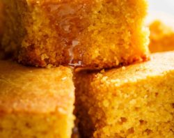 Easy Buttermilk Cornbread with a hint of honey is the perfect side to chili's, soups or stews! Crunchy buttery edges with a soft and fluffy centre!