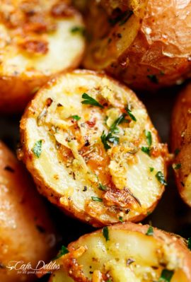 Herbs, garlic, and parmesan cheese are roasted together to make the best Crispy Browned Butter Parmesan Roasted Potatoes! A delicious side dish with so much flavour, these potatoes go with ANYTHING! | cafedelites.com