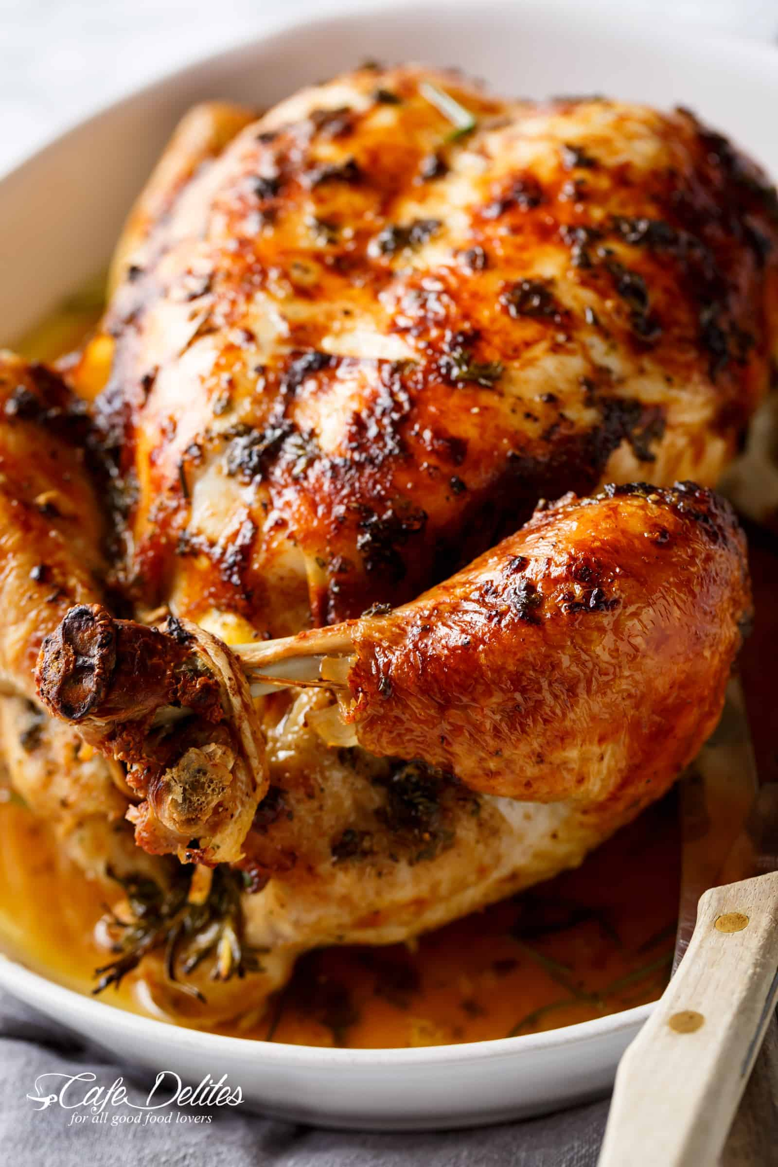 Garlic Herb Butter Roast Chicken | https://cafedelites.com
