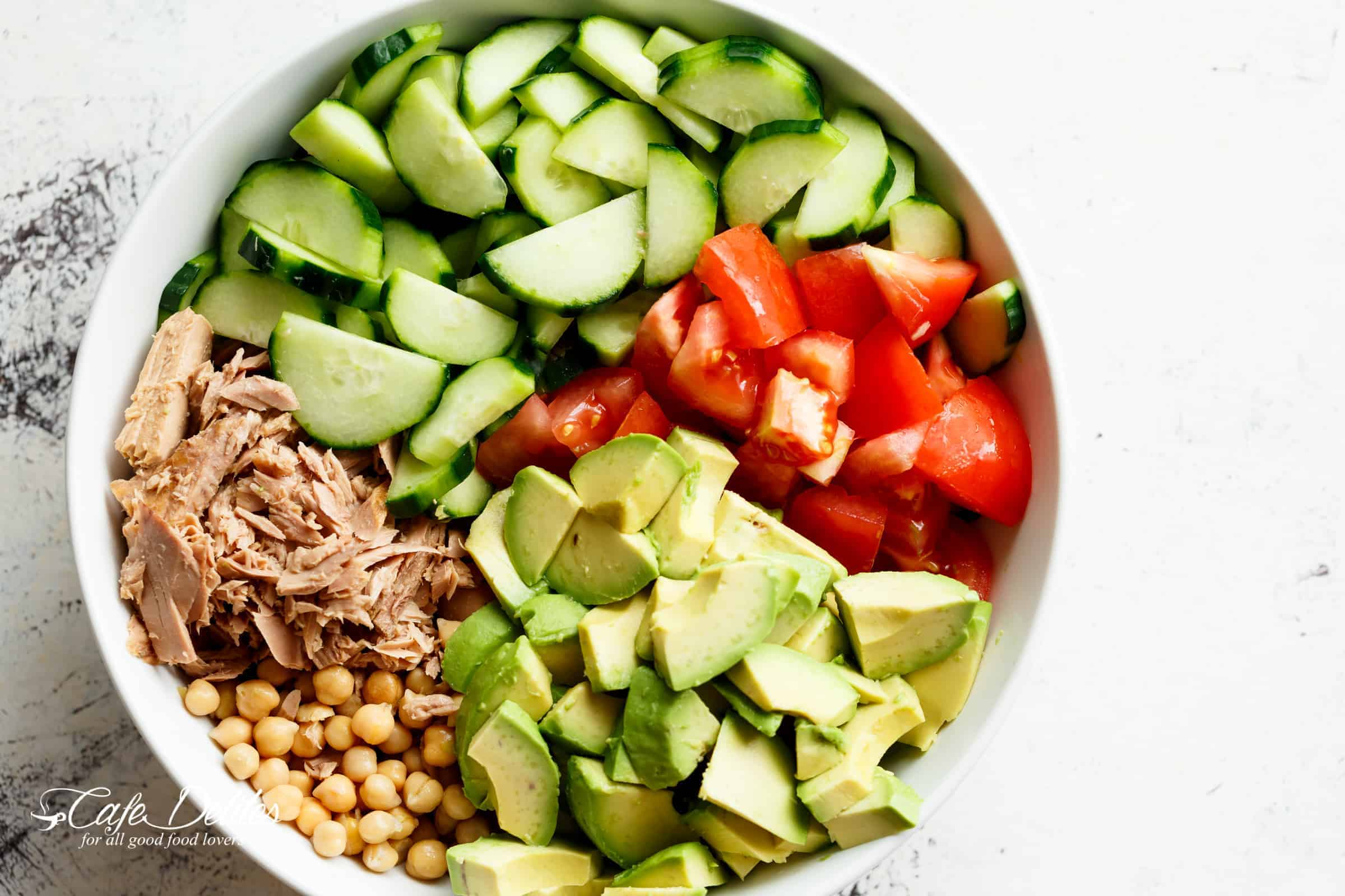Avocado Chickpea Tuna Salad is not only packed with amazing flavours, it is ALSO a bowl full of protein, fibre and healthy fats! | cafedelites.com